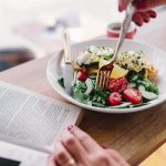 kaboompics-com_eating-fresh-breakfast-and-reading-book-in-morning-2